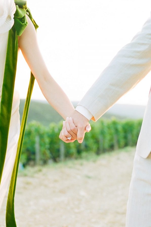 Couple Holding Hands - Feather and Stone Photography
